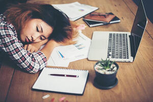 woman-sleeping-at-work_1150-125